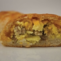 Southern Style Biscuit Stuffed with Egg, Tennessee Sausage and Cheddar Cheese